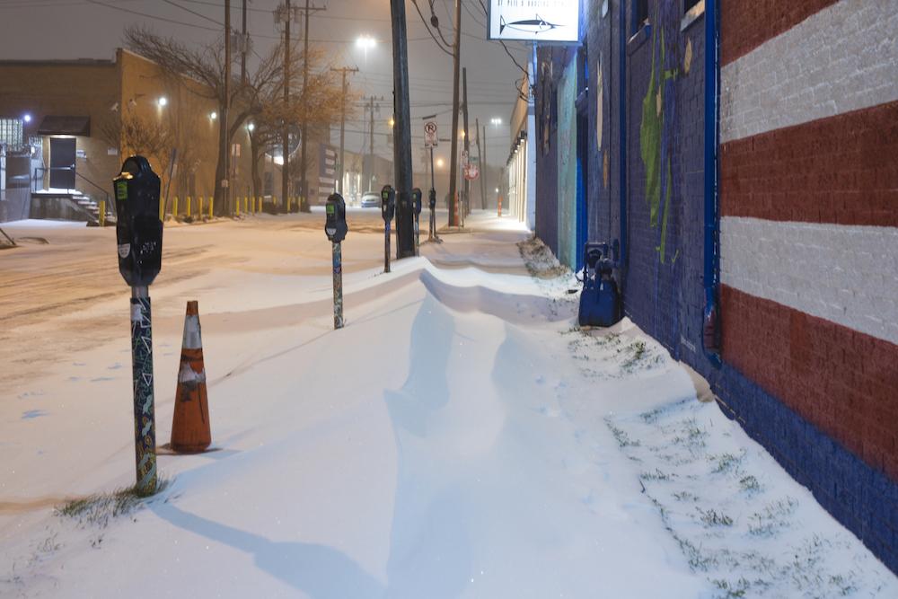 Texas Freeze deep snow in street